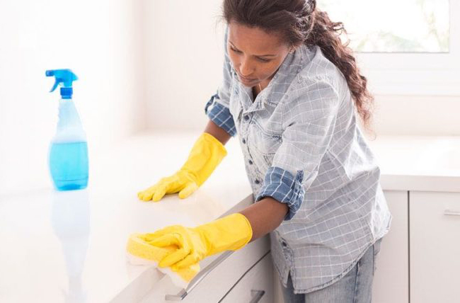 Woman clean the kitchen